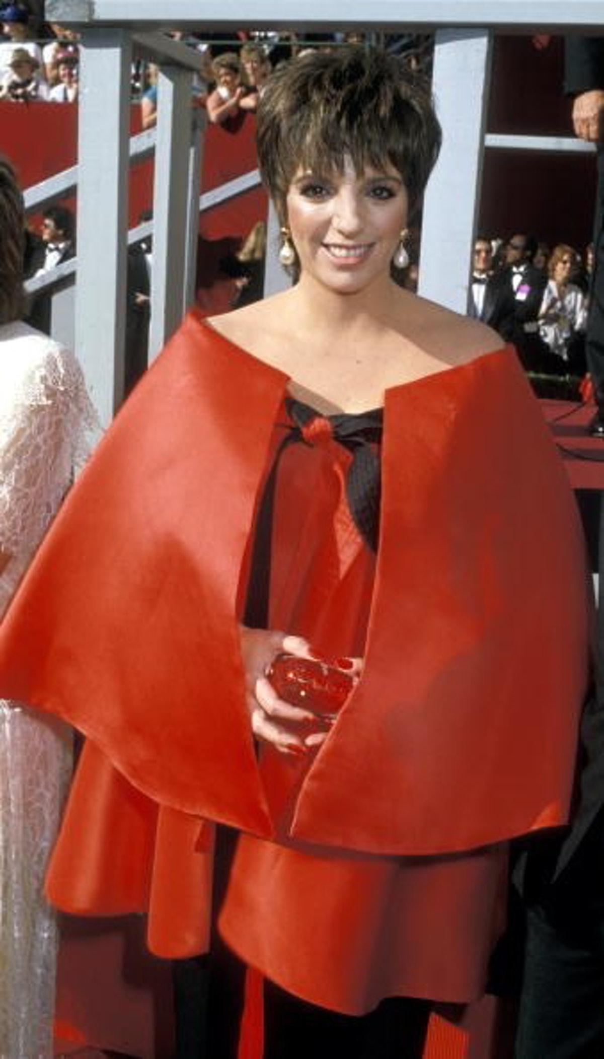 Liza wears a red gown