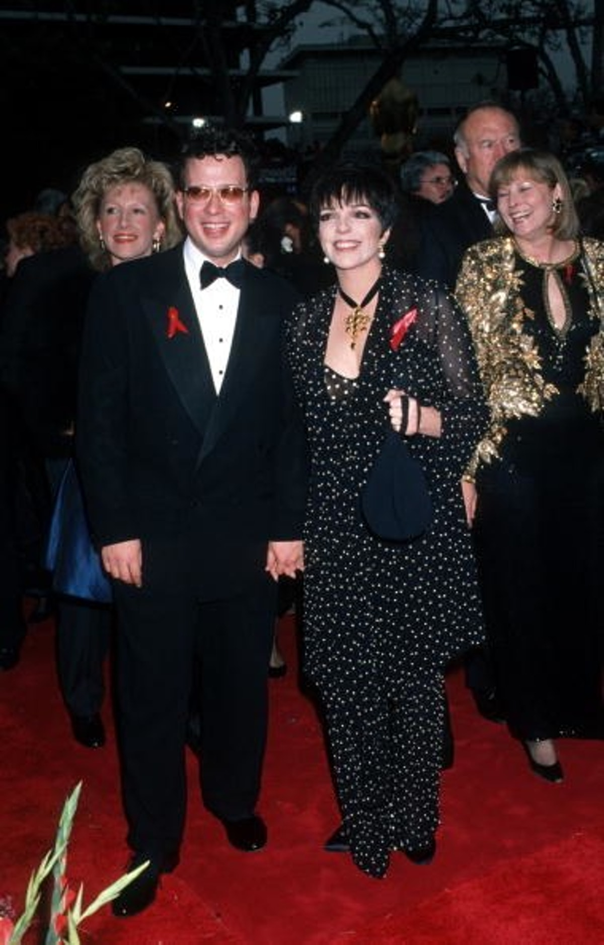 Minnelli wears a black and white draped suit