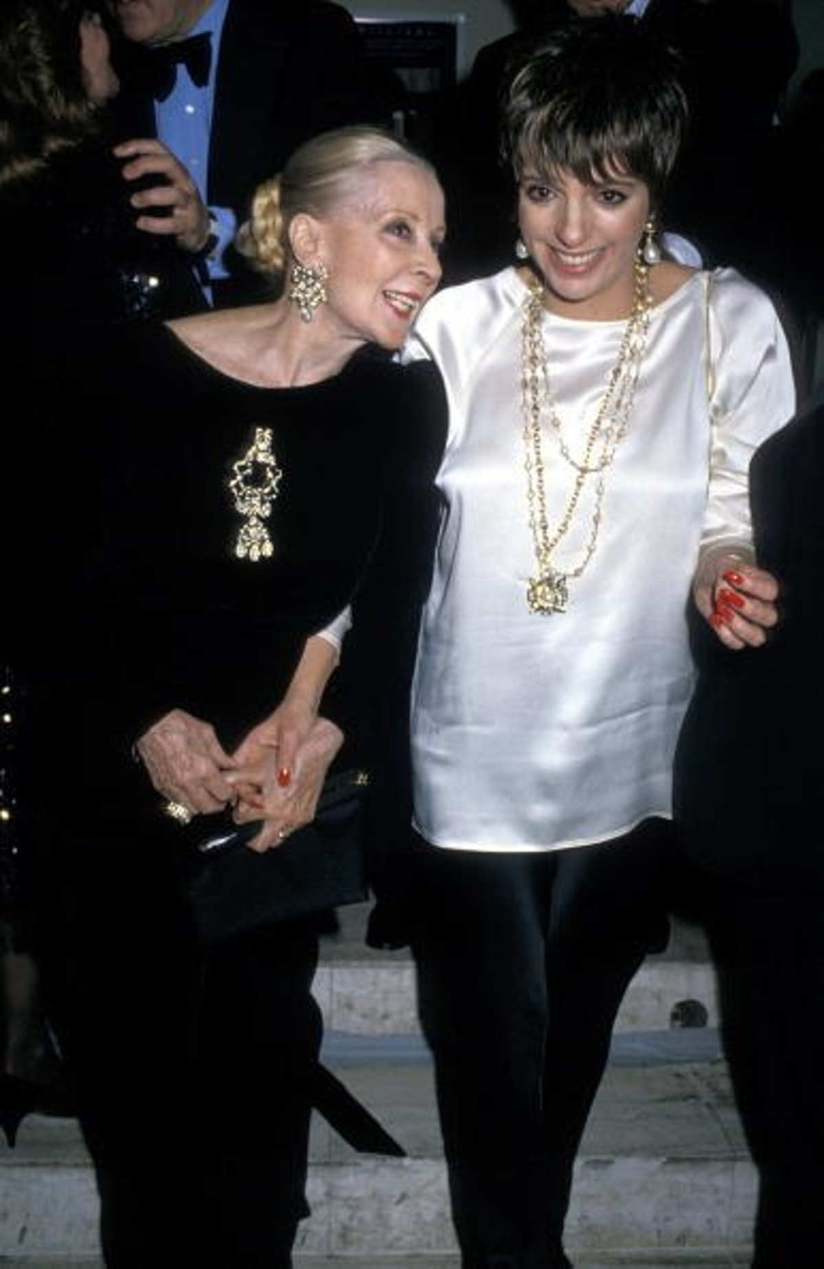 Minnelli dons a classic silk top and black trousers