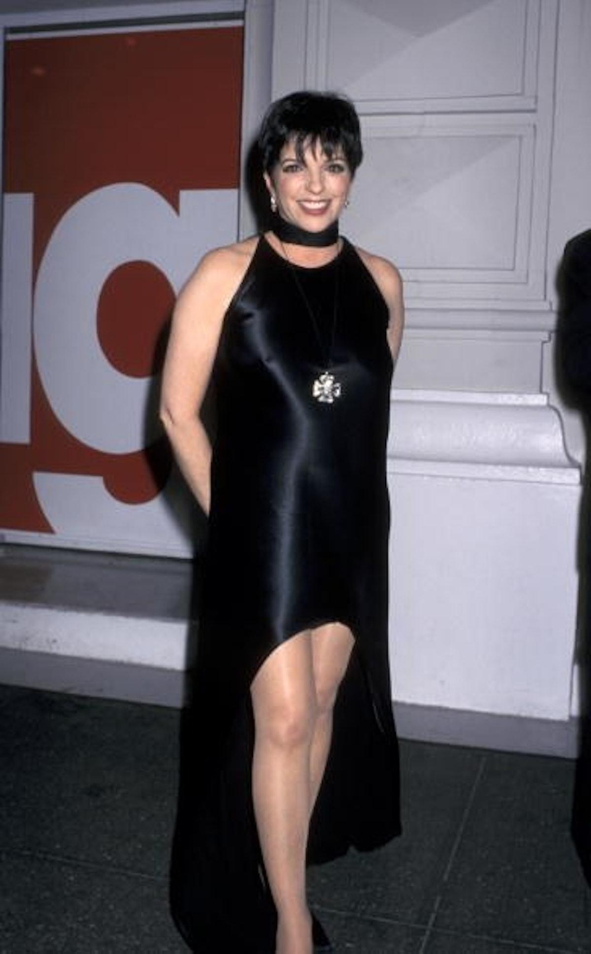 Liza In a high-low black silk dress