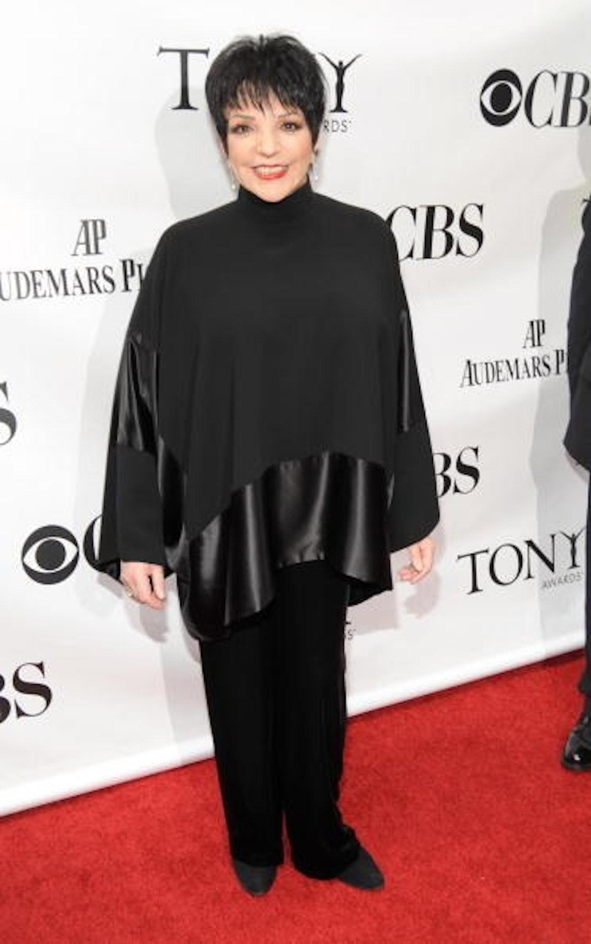 Liza wears all black