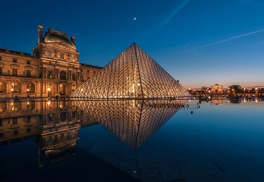 Pyramid at Louvre Museum with The Moon