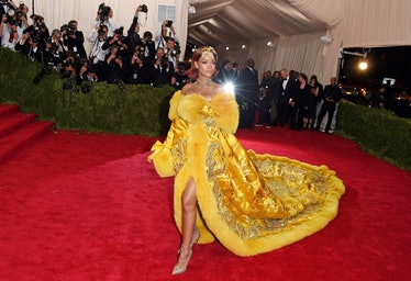 Rihanna in yellow coat