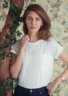 Sofia Coppola in a white t-shirt.