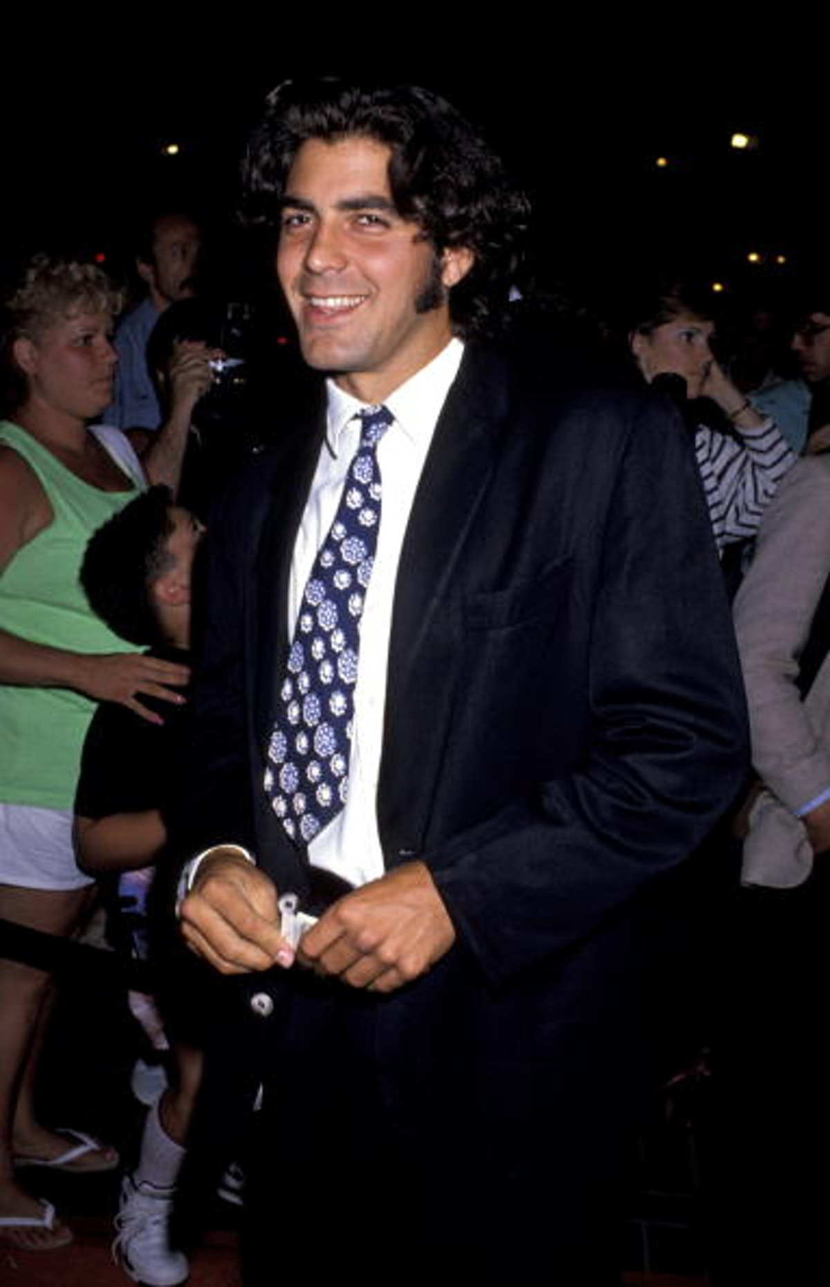 George Clooney in a multicolored tie with long hair