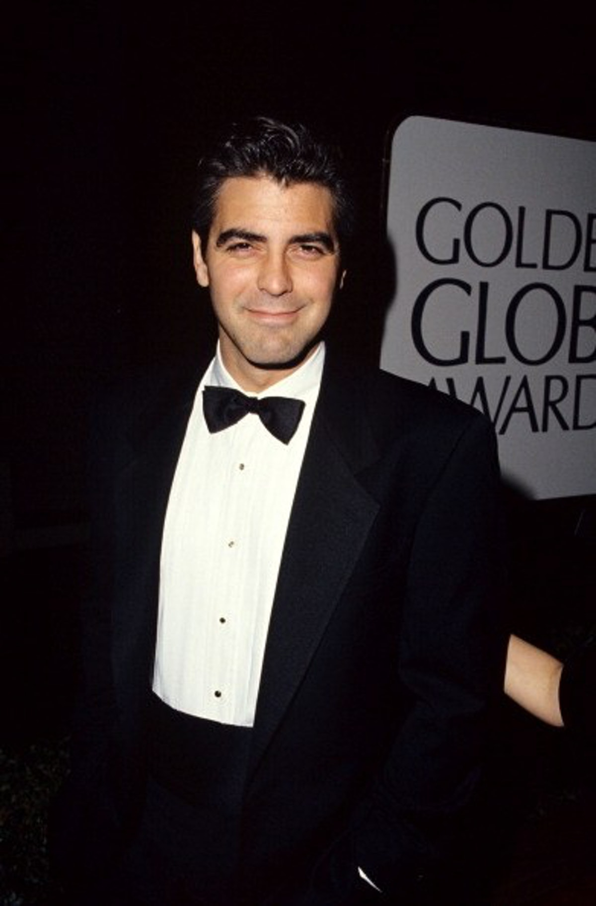 George in a black tux with black hair