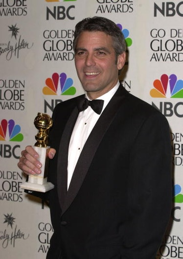 George holding a Golden Globe