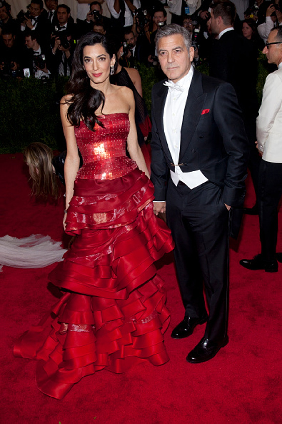 George Clooney in a black and white tux, Amal in a red gown