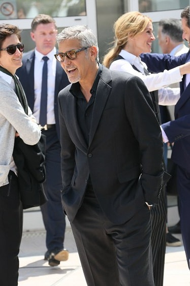 George Clooney wearing a black suit