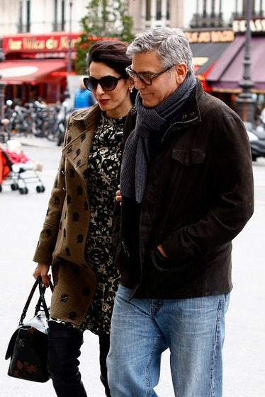 George in a cozy scarf next to Amal