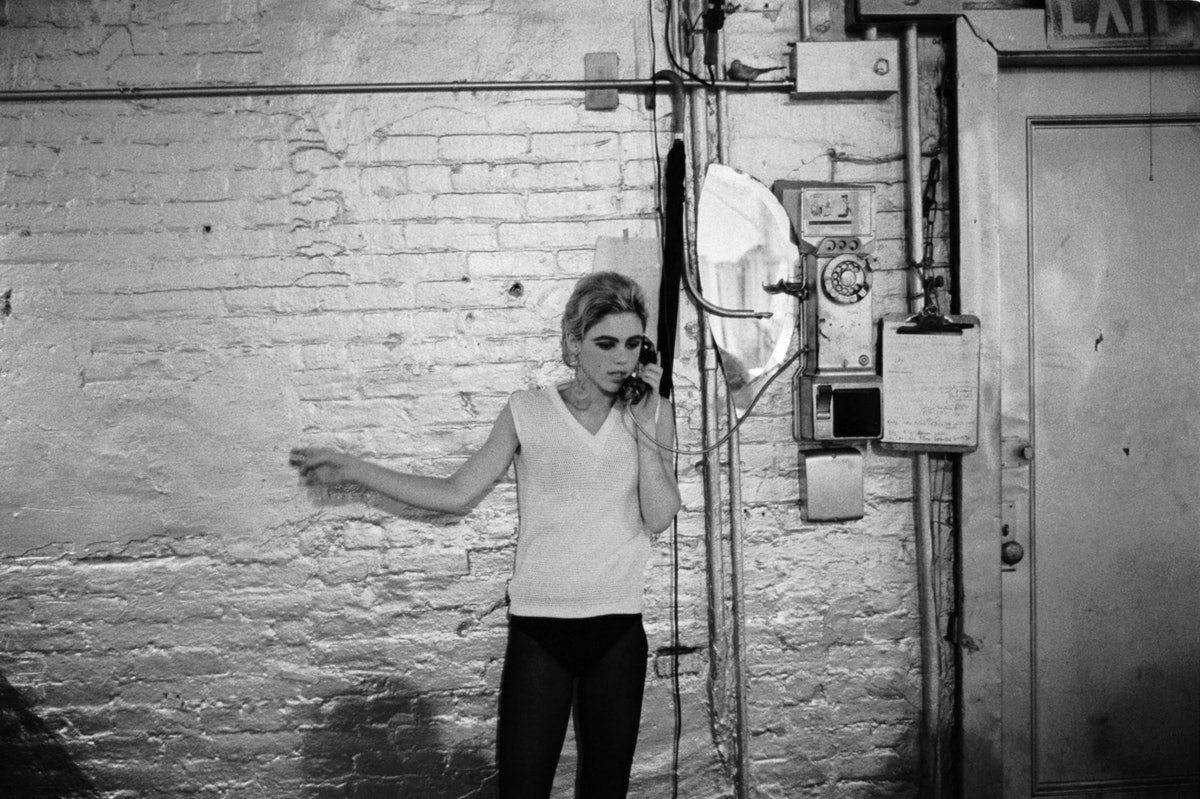 Stephen-Shore_Edie-Sedgwick-using-the-only-phone-in-the-Factory,-1965-67.jpg