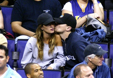 Leo and Giselle kissing.