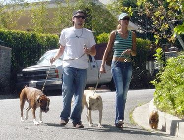 Gisele and Leonardo with dogs.