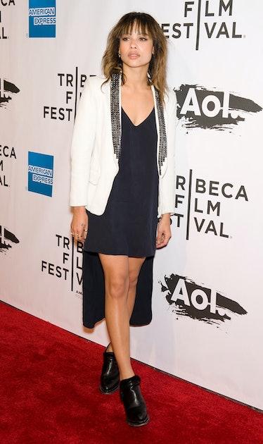 Zoe Kravitz in white coat.
