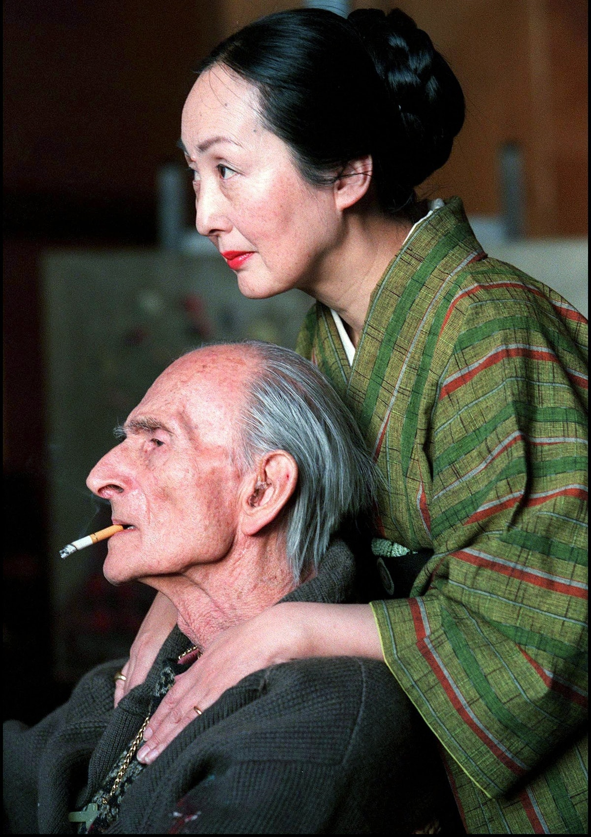 Painter Balthus and his wife Setsuko in their wooden hut of Rossiniere, Switzerland in February, 199...