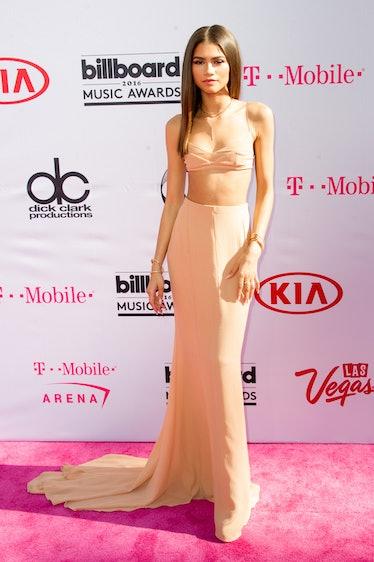 Zendaya in nude dress.