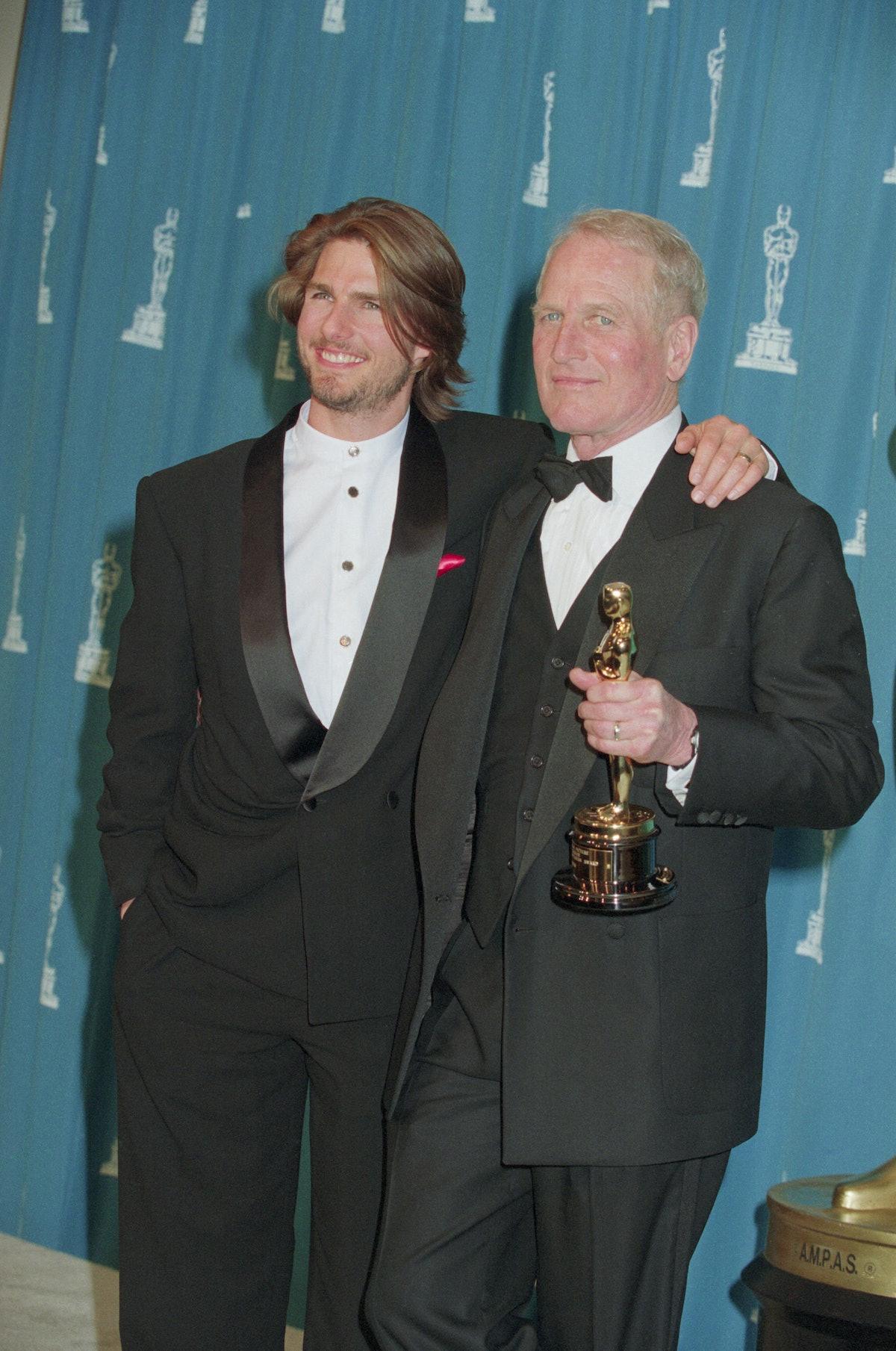 Tom Cruise with Paul Newman Holding an Oscar