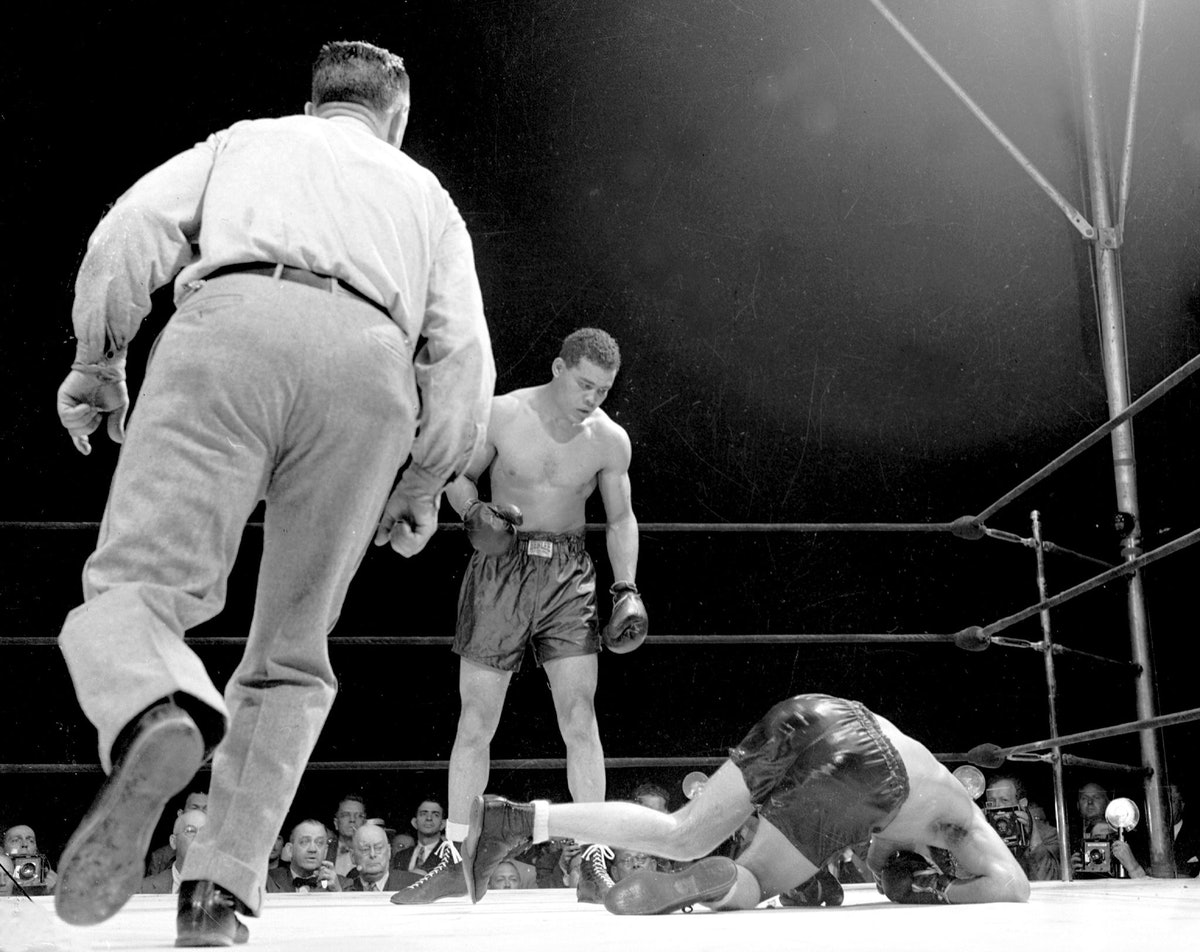 Billy Conn hits the canvas after being hit by punch thrown b