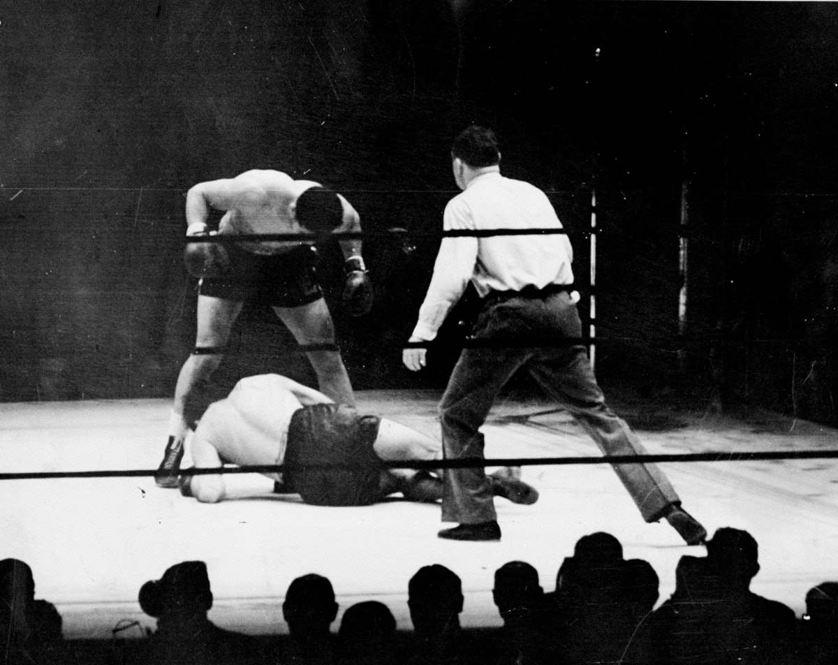 Joe Louis stands over his fallen foe, Max Schmeling, after b