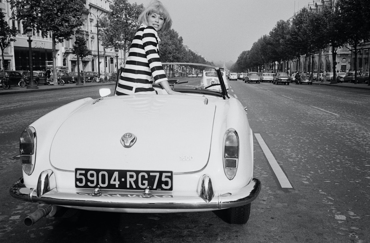 Actress Mireille Darc Driving Convertible