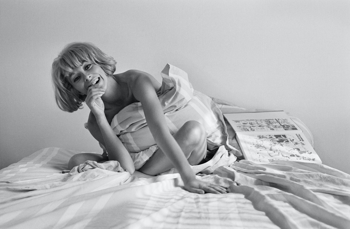 Actress Mireille Darc Laughing in Bed