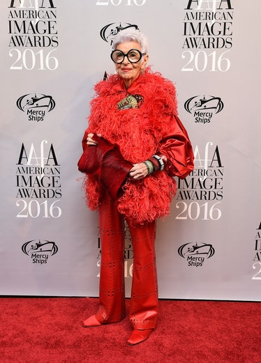 Iris Apfel wearing red