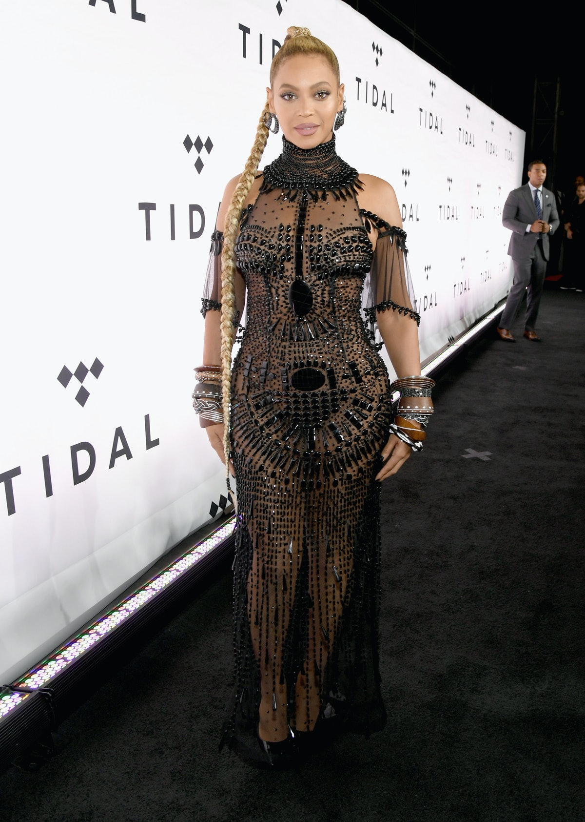 Beyonce wearing black beaded gown and high braided ponytail