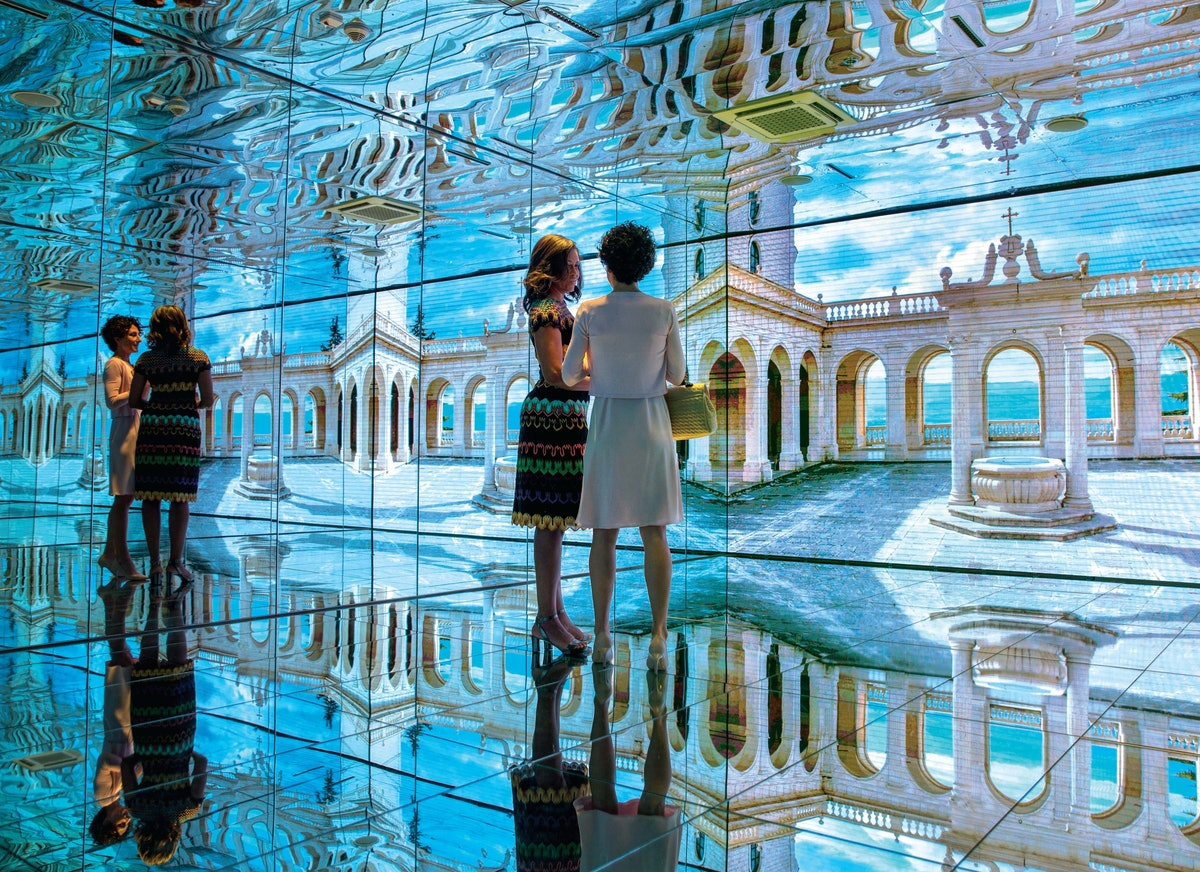 Chasing Light p. 180-181--Mirror Room with Mrs. Agnese Landini at the Milan Expo.jpg