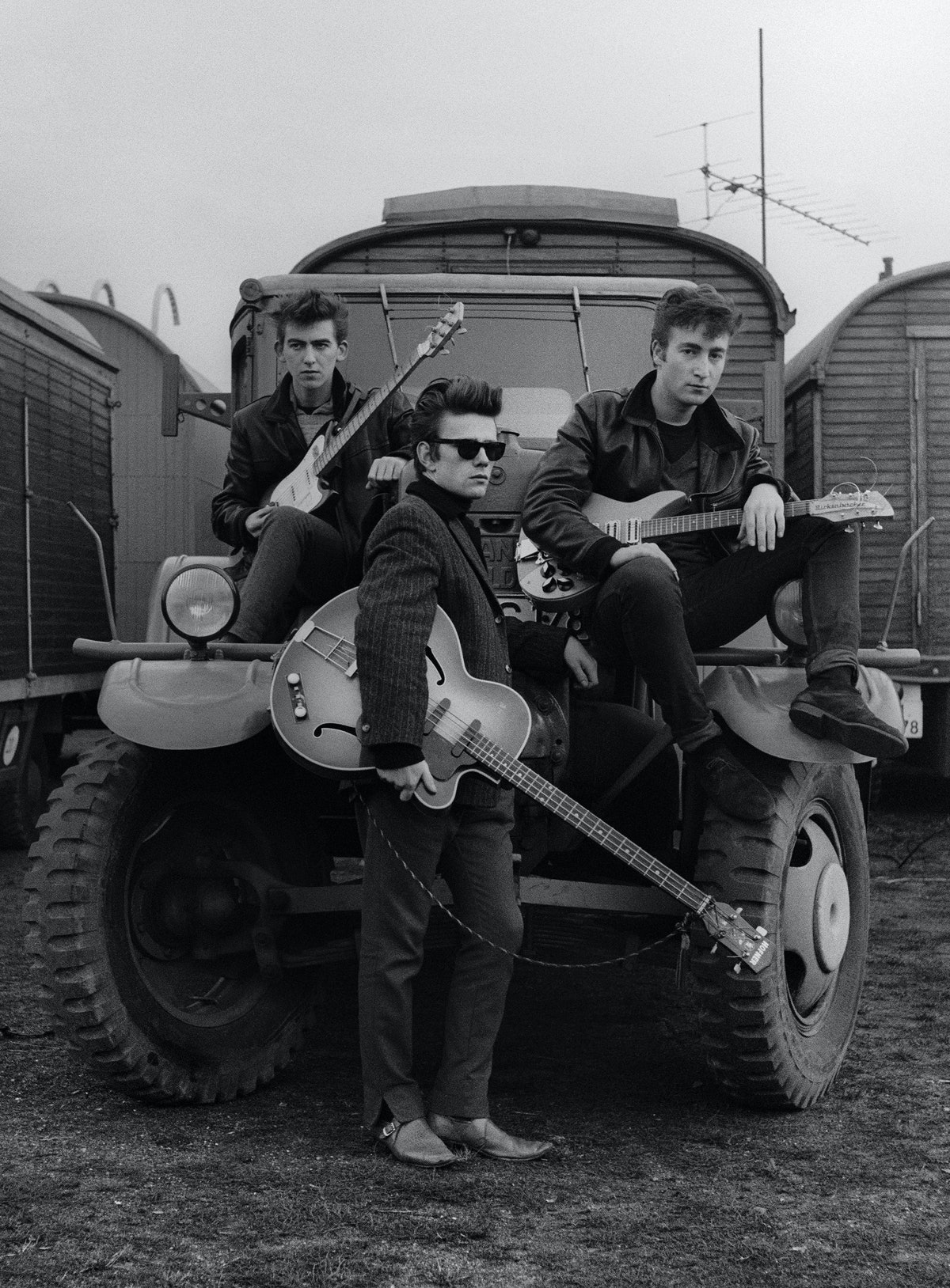 Astrid_Kirchherr_John_Lennon_Stuart_Sutcliffe_and_George_Harrison_on_a_truck_at_the_Fairground_1960_HR.jpg