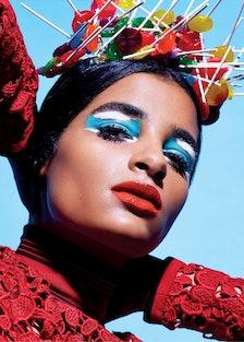 Salvatore Ferragamo turtleneck; candy headpiece by hairstylist Recine. Beauty note: Play up lids wit...