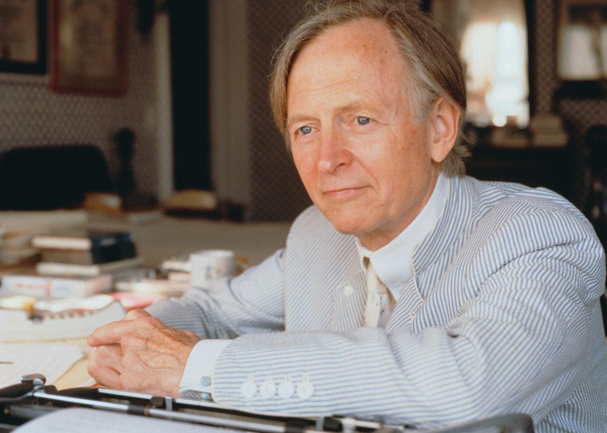Novelist Tom Wolfe Seated at Desk
