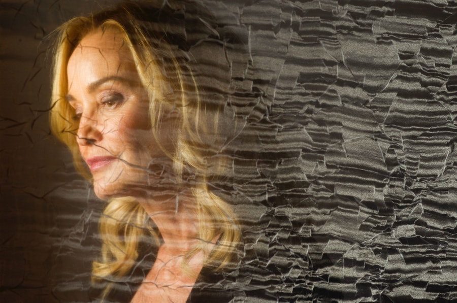 Actress Jessica Lange, photographed through a cracked veil,  sits for a portrait at the Four Season