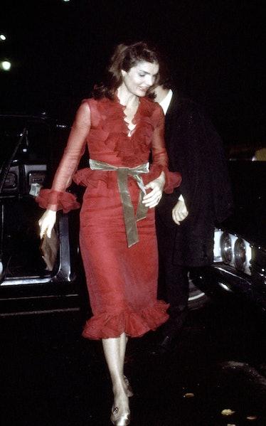 Jackie O wearing red