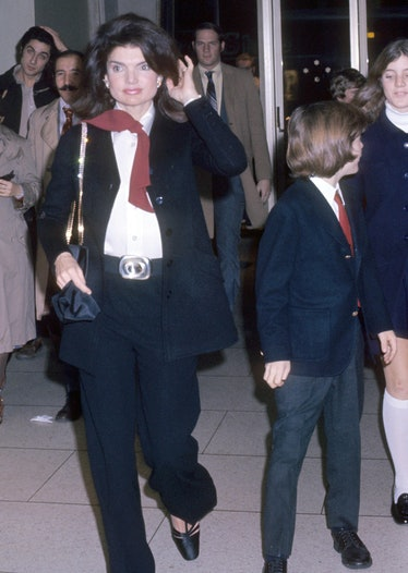Jackie O wearing a suit