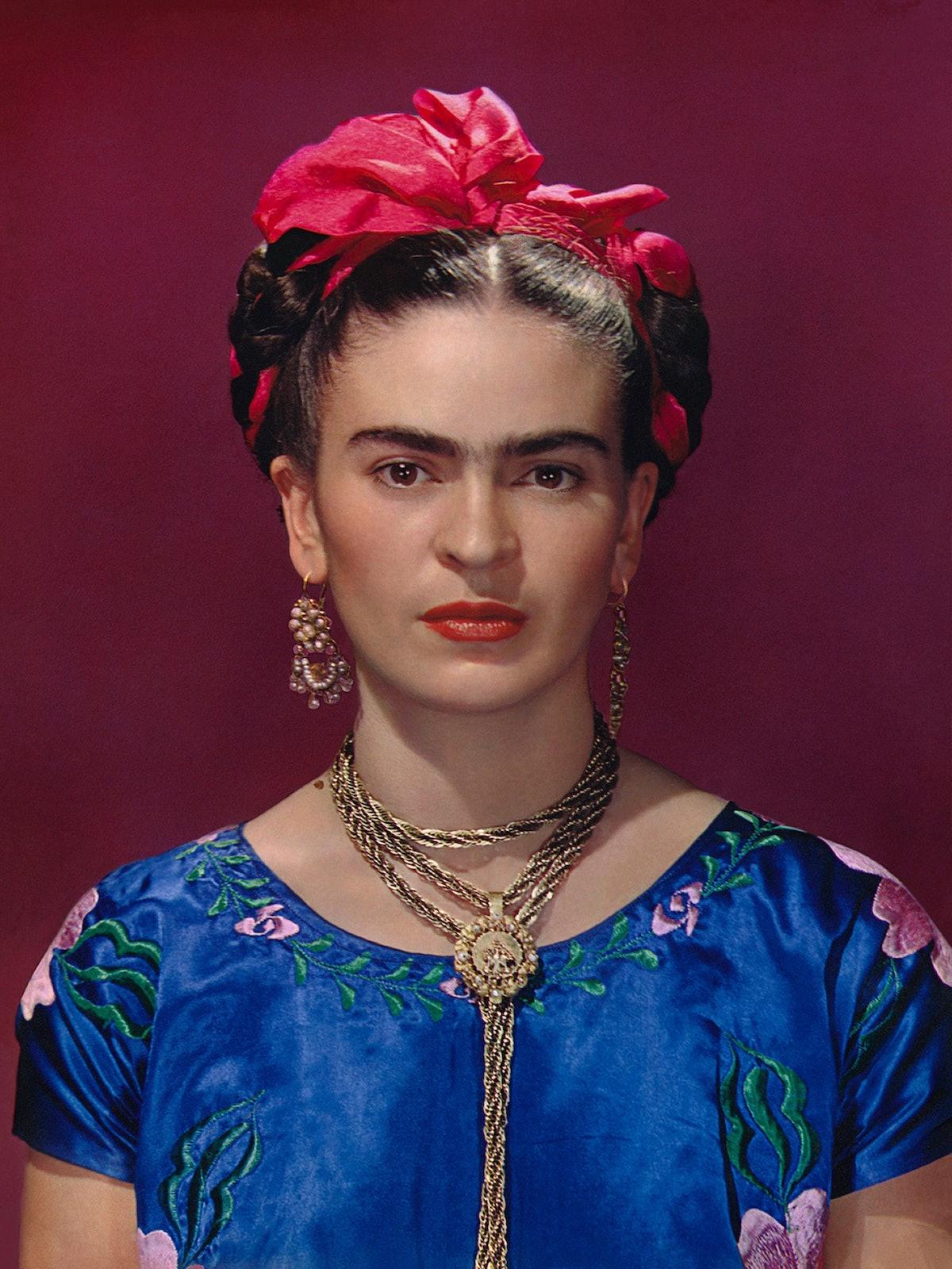 Frida Kahlo in blue satin blouse, 1939. Photograph Nickolas Muray © Nickolas Muray Photo Archives.jp...