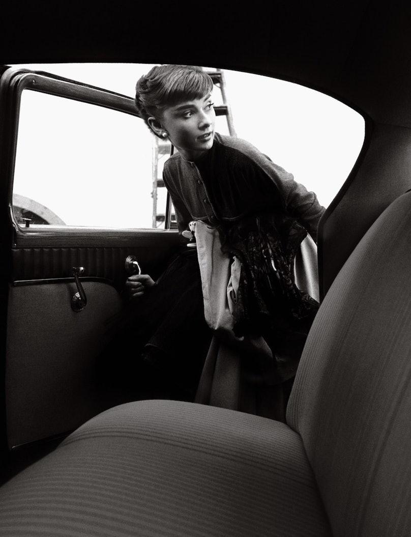 Audrey Hepburn getting into the Paramount Studios car, 1953, Bob Willoughby.jpg