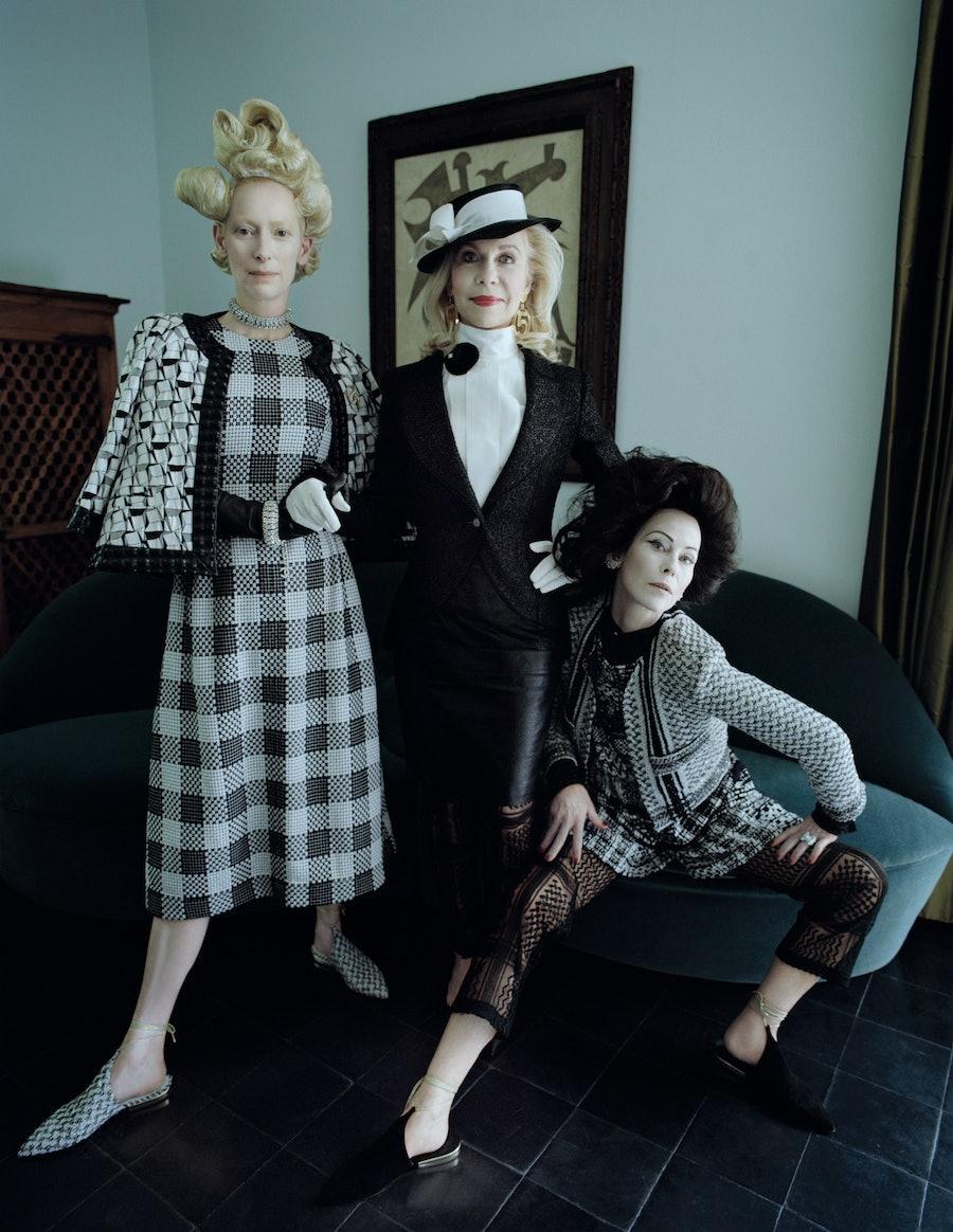Swinton wears a Chanel jacket, dress, necklace, brooch, bracelet, and shoes; Perrin Paris gloves. Lynn Wyatt, a Houston socialite and friend of the de Menils, wears her own Chanel jacket, shirt, skirt, hat, earrings, brooch, and pumps; a Chanel jumpsuit (