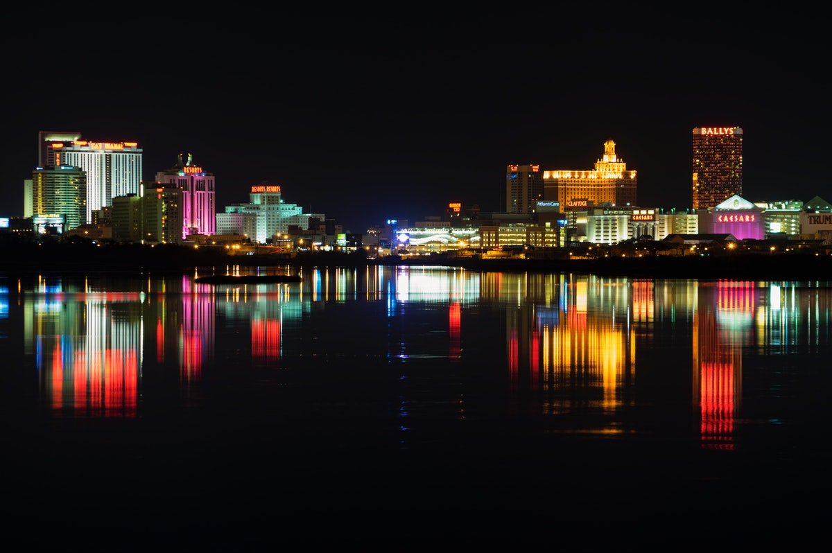 Atlantic City skyline reflected on the water.