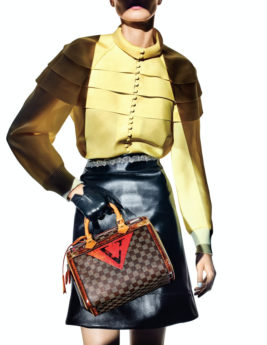 208LEGENDS OF THE FALLLouis Vuitton Speedy Time Trunk bag, blouse, belted skirt, and glove.