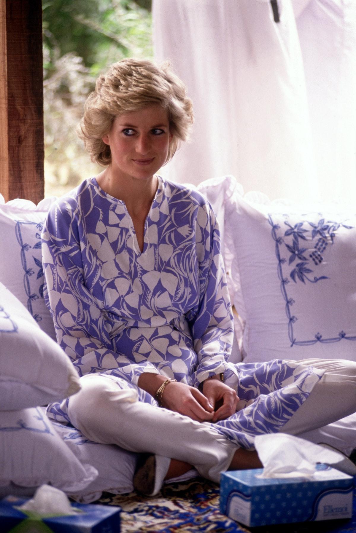 Princess Diana sitting cross-legged