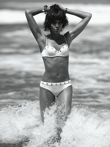 Versace swimsuit. Beauty note: Flaunt a bikini-ready body with Soap & Glory Sit Tight Intense XS Bod...