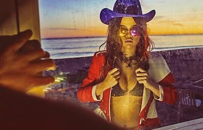 Alexander McQueen jacket; Missoni bikini; JJ Hat Center hat; Giamba sunglasses; Prada neck piece. Fo...