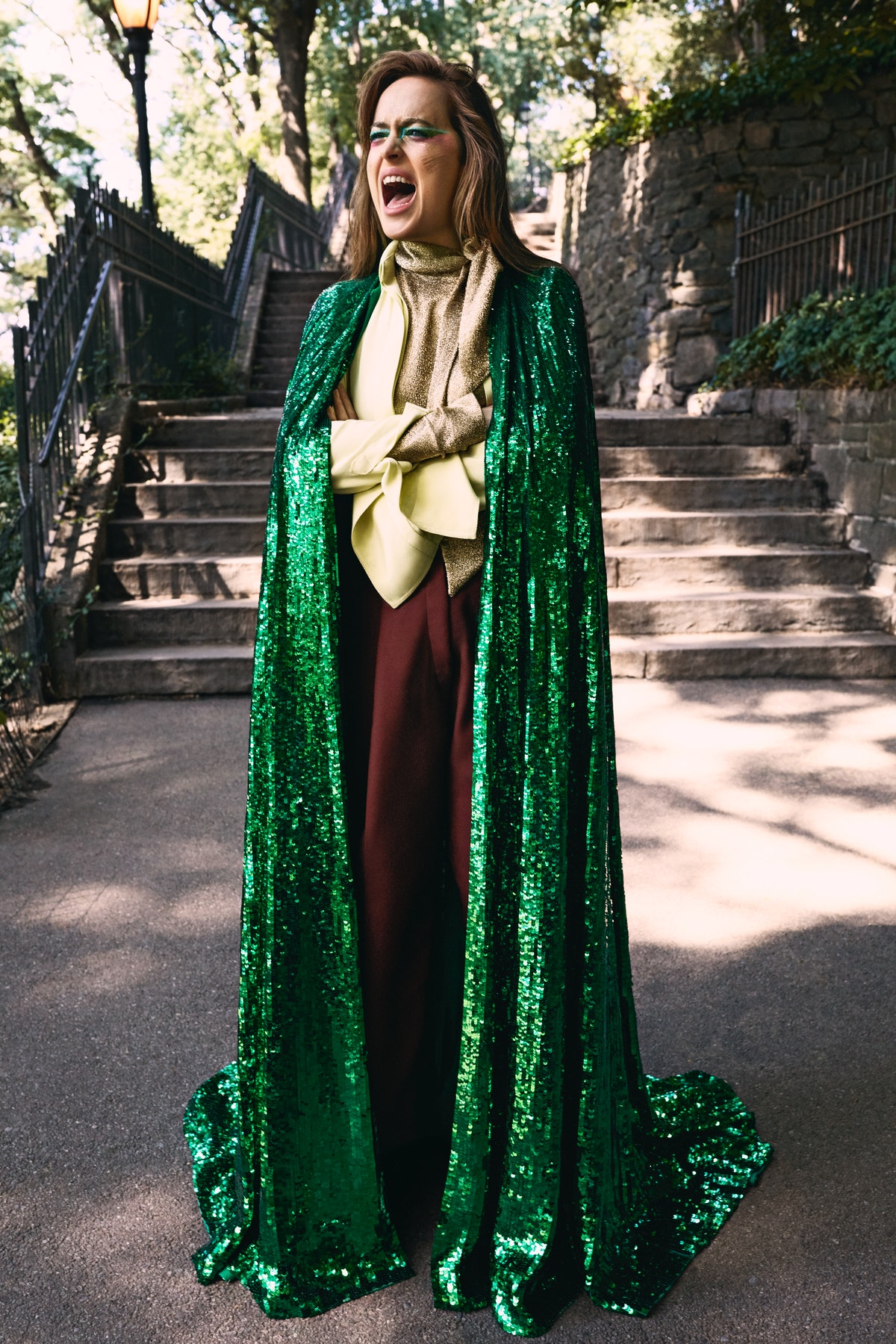 Valentino Haute Couture cape, shirt, blouse, and pants.