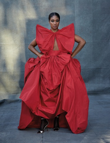 Tiffany Haddish wears a Valentino Haute Couture gown and sandals; Falke tights. Beauty: Nars All Day...