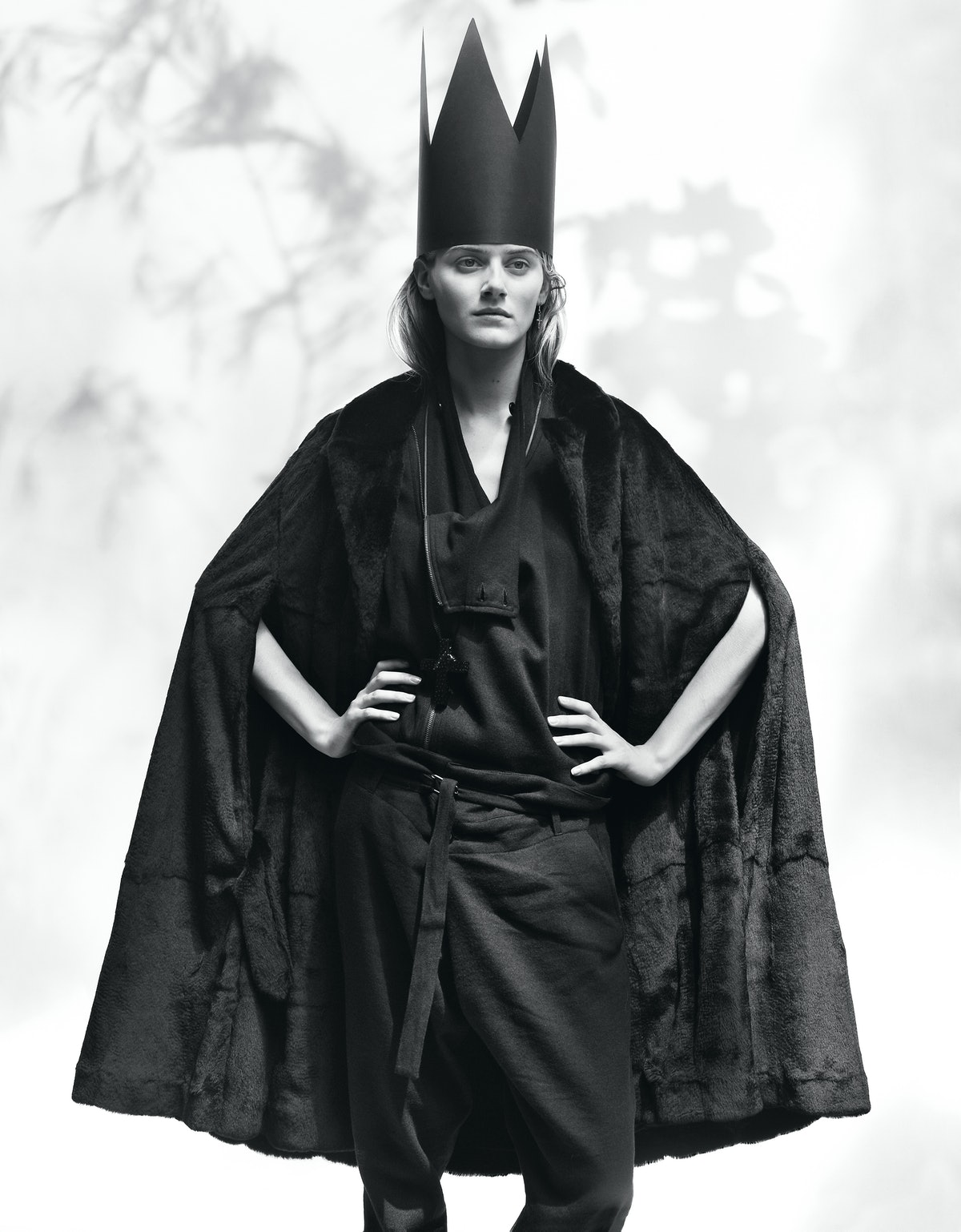Ann Demeulemeester's black weasel fur and leather cape and black wool, linen, and cotton coat and pa...