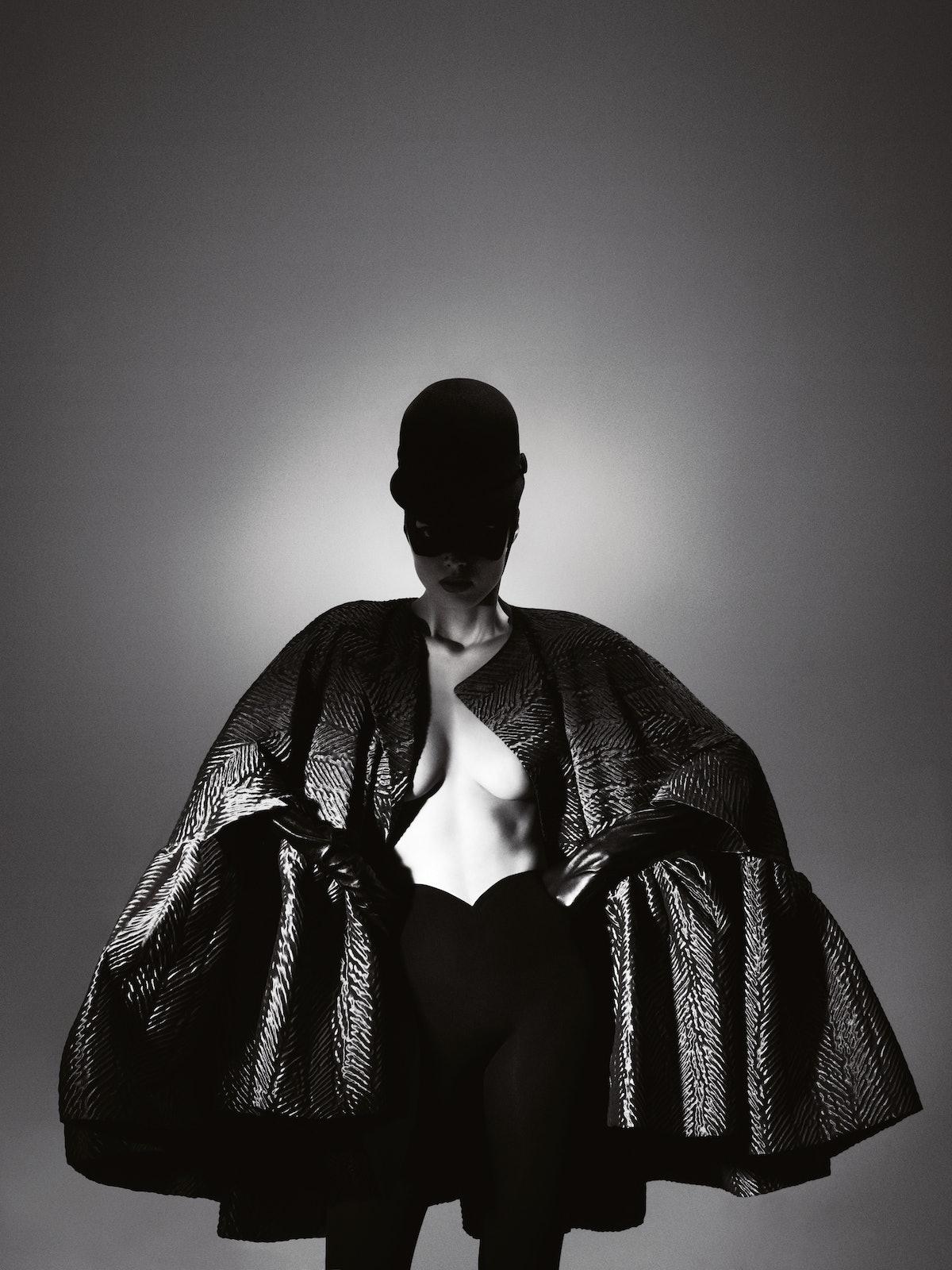 Balenciaga's gray silk and polyester coat, by Nicolas Ghesquière, at Balenciaga, New York. Balenciag...