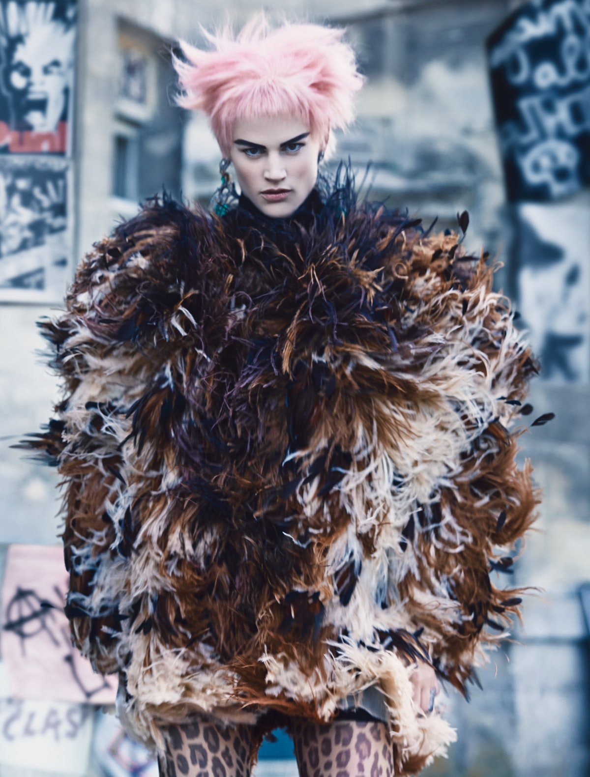 Gaultier Paris coat; Repossi ring; Fogal tights. Beauty note: Skin stays calm and unruffled with Jur...