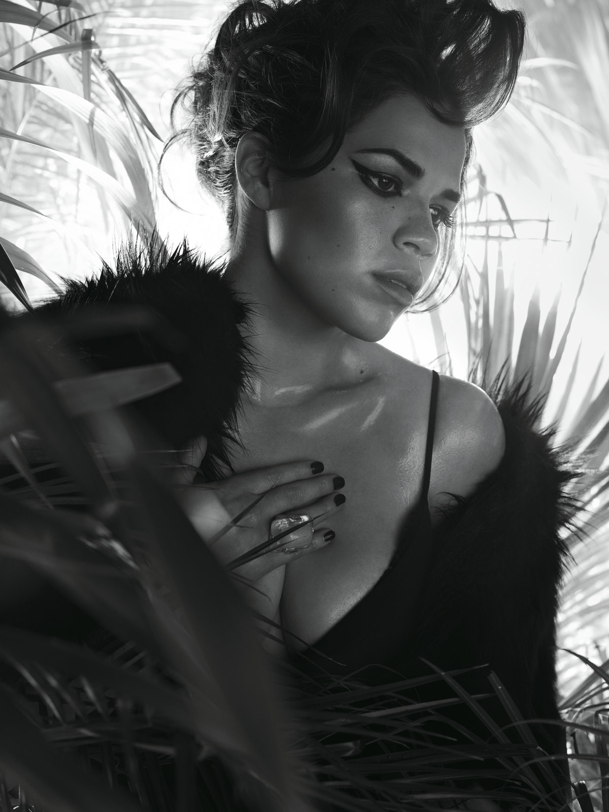 """In """"Hot Betty,"""" page 164,Ugly Betty star America Ferrera looks drop-dead gorgeous in Armani Collezione's silk dress with lace insets and Alexander McQueen's fox fur cape. Kara Ross ring."""