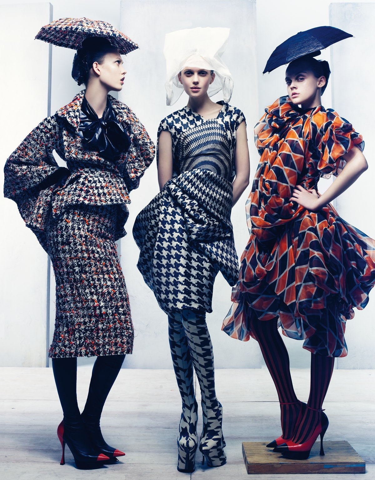 FROM LEFT: ALEXANDER McQUEEN'S SILK TWEED JACKET AND SKIRT AND POLYESTER BLOUSE, AT ALEXANDER McQUEEN, NEW YORK. PHILIP TREACY FOR ALEXANDER McQUEEN HAT; ALEXANDER McQUEEN GLOVES AND SHOES WITH ATTACHED HOSIERY. ALEXANDER McQUEEN'S SILK ORGANZA DRESS, TO ORDER, 212.645.1797. PHILIP TREACY FOR ALEXANDER McQUEEN HAT; ALEXANDER McQUEEN SHOES WITH ATTACHED HOSIERY. ALEXANDER McQUEEN'S SILK DRESS, AT ALEXANDER McQUEEN, NEW YORK. PHILIP TREACY FOR ALEXANDER McQUEEN HAT; ALEXANDER McQUEEN HOSIERY AND SHOES.