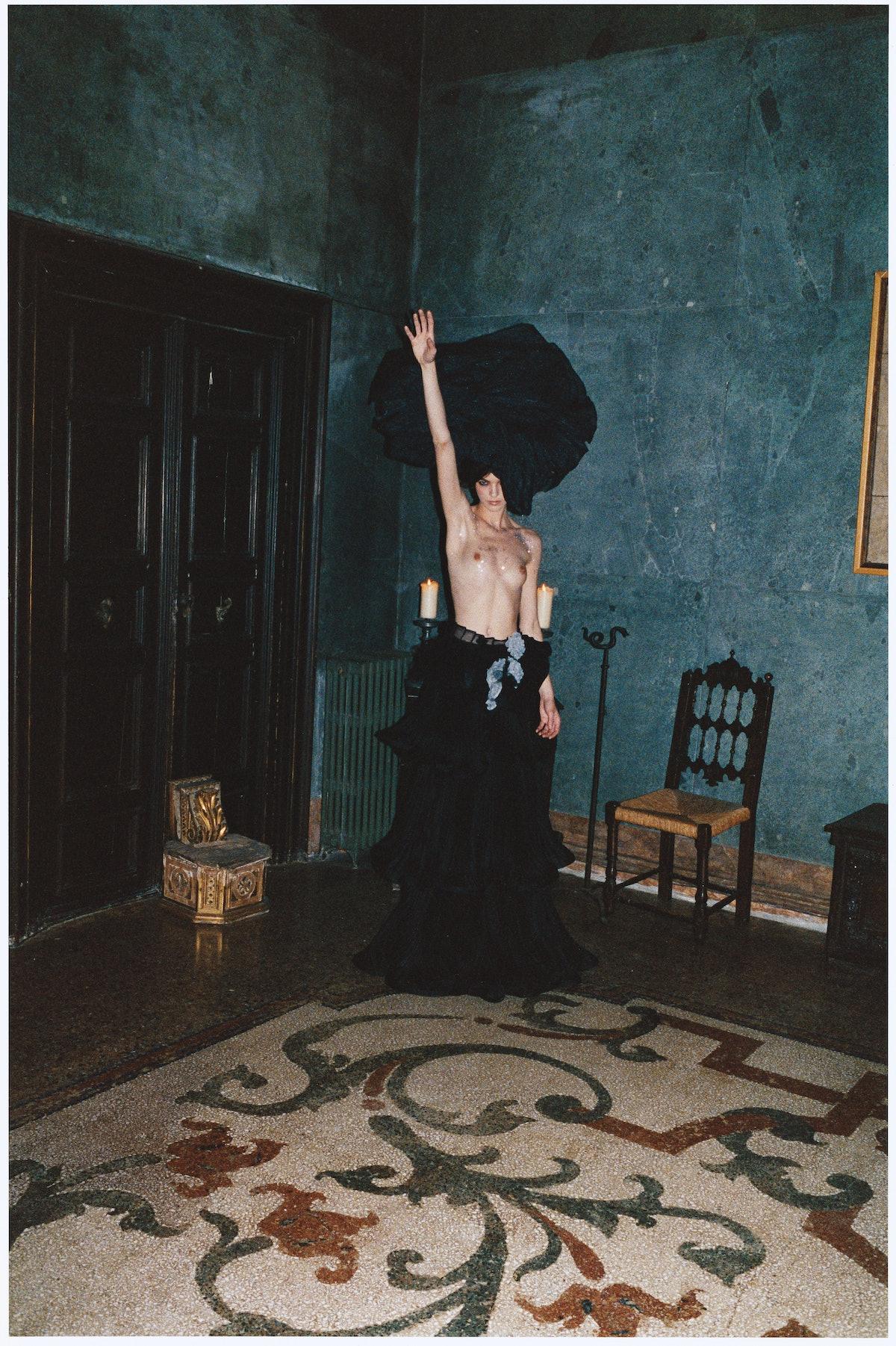 Giorgio Armani's silk skirt, at Saks Fifth Avenue; Giorgio Armani, giorgioarmani.com. Alexander McQueen hat; Louis Vuitton collar (worn as belt).